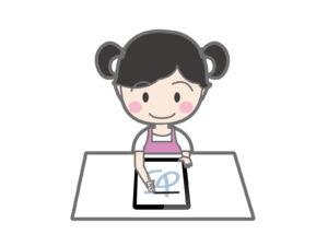 タブレットで字の練習をする女の子